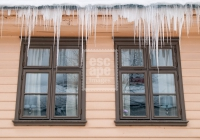 Huge icicles hanging from a building in town