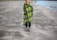 Anne Marie wrapped up on the beach, Tofino