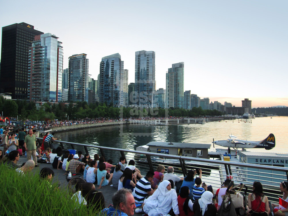 Crowds gather to watch the Canada Day Fireworks